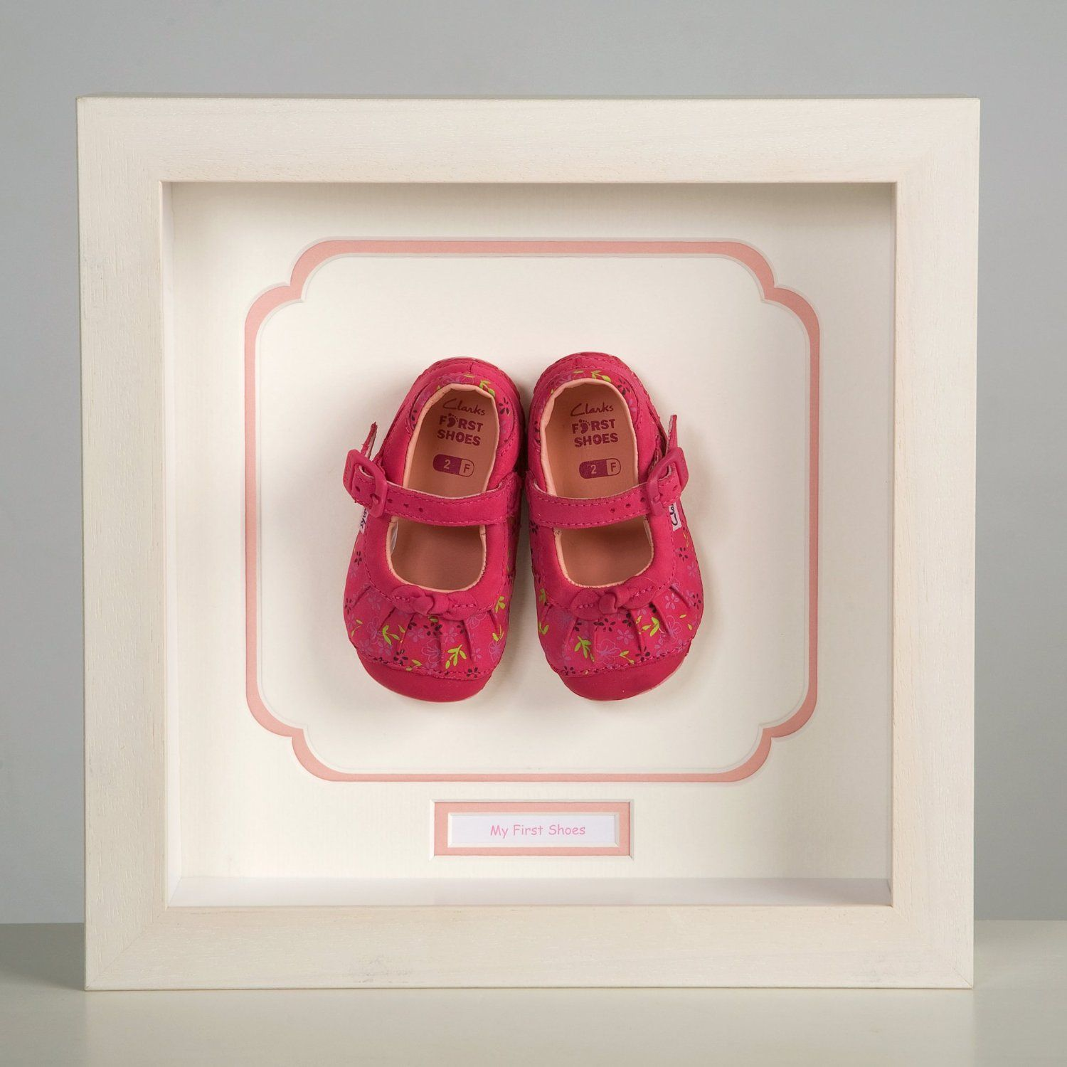 Keepsake Frame to display a child's first shoes, pink