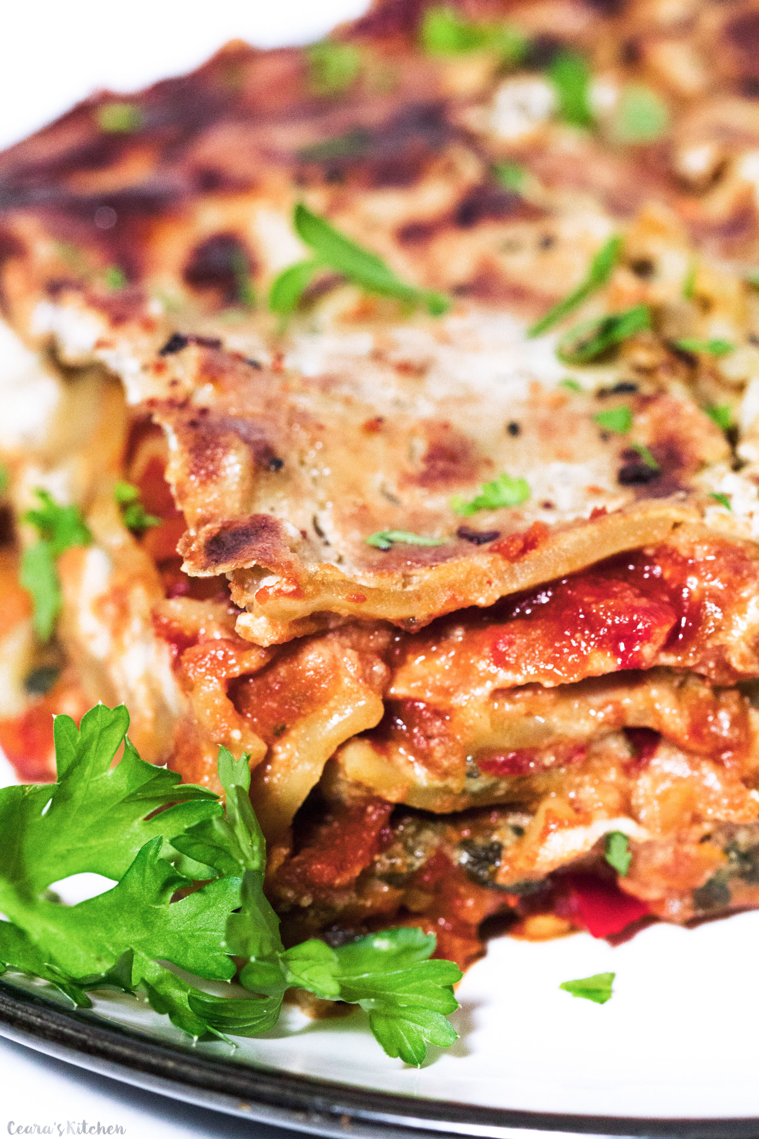 Hearty, cheesy, meaty and comforting #Vegan Lasagna. This lasagna is perfectly layered with a thick and meaty tomato sauce and a cheesy, ricotta-style cheese sauce. One of my favorite recipes to make on the weekend. #Vegetarian #Lasagna #MeatlessMonday