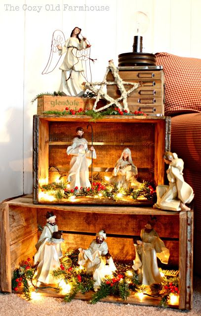 a beautiful nativity display using crates found at the cozy old farmhouse blog nativity