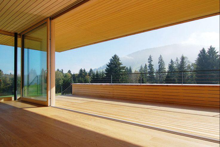 Die Holzverkleidung verbindet Innen- und Außenraum Die klaren - holzverkleidung innen modern
