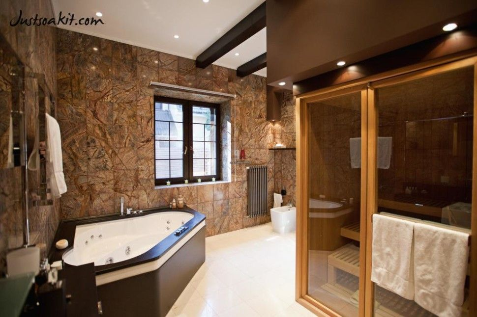 http://www.justsoakit.com/wp-content/uploads/2015/01/elegance-bathroom-interior-design-with-corner-bathtub-with-brown-tile-wall-including-lighting-idea-in-ceiling-as-well-towel-shelves-beside-double-glass-window-970x646.jpg