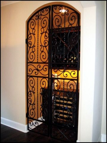 Beautiful Wrought Iron Wine Cellar Door