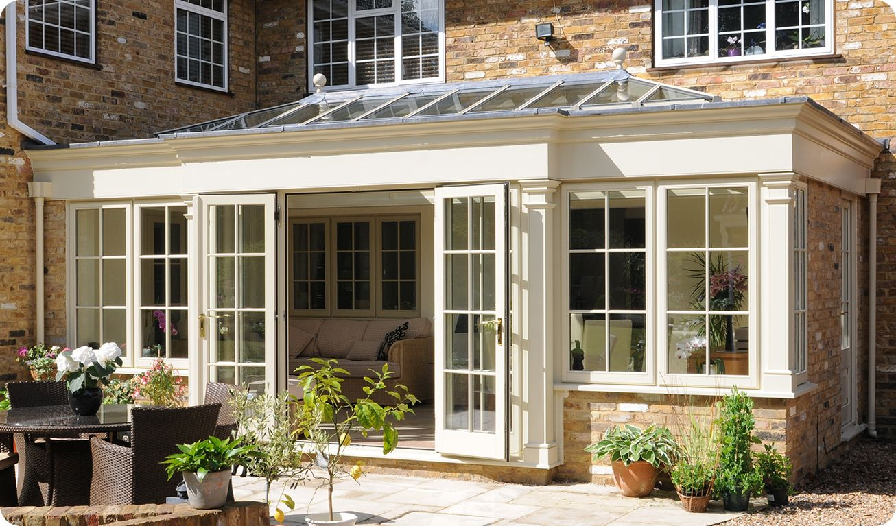 Glass conservatory additions if you go with the wooden for Conservatory doors exterior