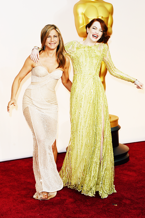 """""""Jennifer Aniston and Emma Stone attend the 87th Annual Academy Awards at Hollywood & Highland Center on February 22, 2015 in Hollywood, California. """""""