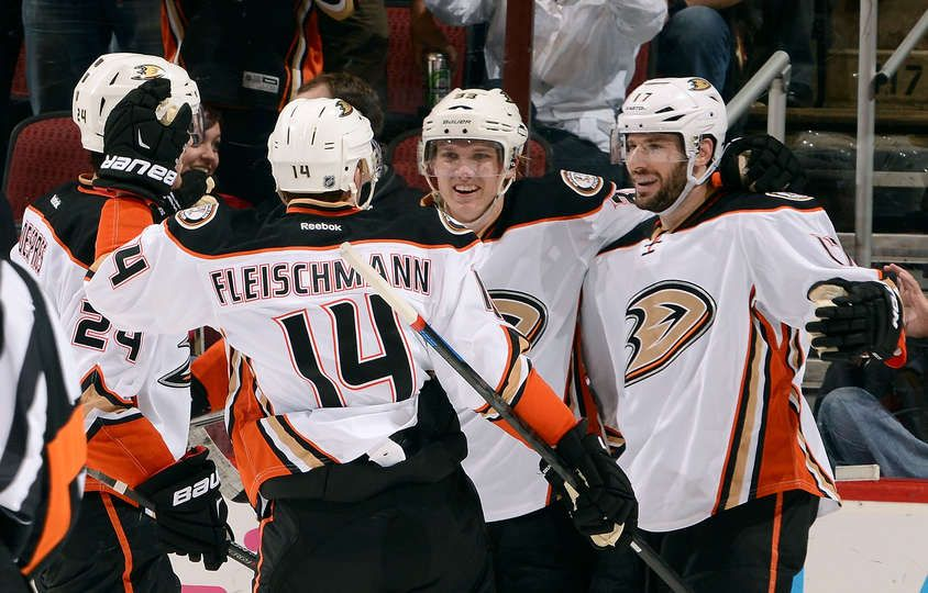 Jakob Silfverberg #33 of the Anaheim Ducks (C) celebrates with teammates Simon Despres #24, Tomas Fleischmann #14 and Ryan Kesler #17 after his third period goal against the Arizona Coyotes