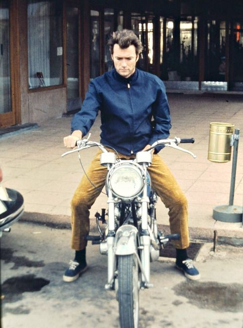 Clint Eastwood is photographed on his motorcycle, c. late 1960s.