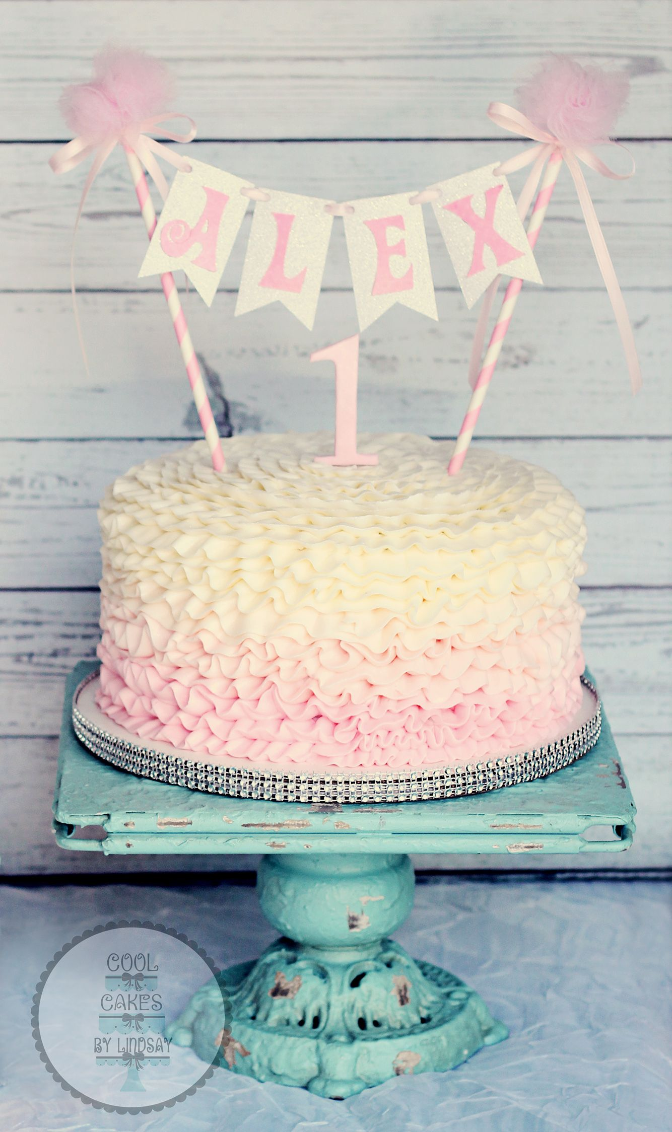 Pink ombre buttercream ruffles cake with bunting 1st birthday