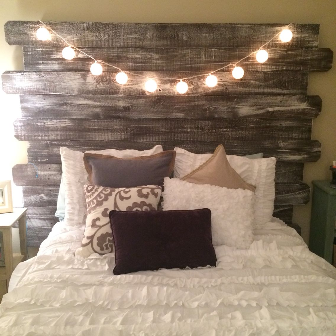 Whitewashed rustic headboard made from fenceposts decor