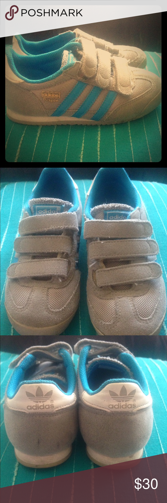 ⛔️SOLD⛔️Children adidas suede tennis 11 Used children adidas dragon tennis shoes .. These are sooo cute and still in good condition .. Gray suede Velcro with blue stripes and trimming sz 11.. Little dirty marks here and there .. Can be cleaned by the buyer I'm sure .. The last pic shoes the most obvious dirt mark Adidas Shoes