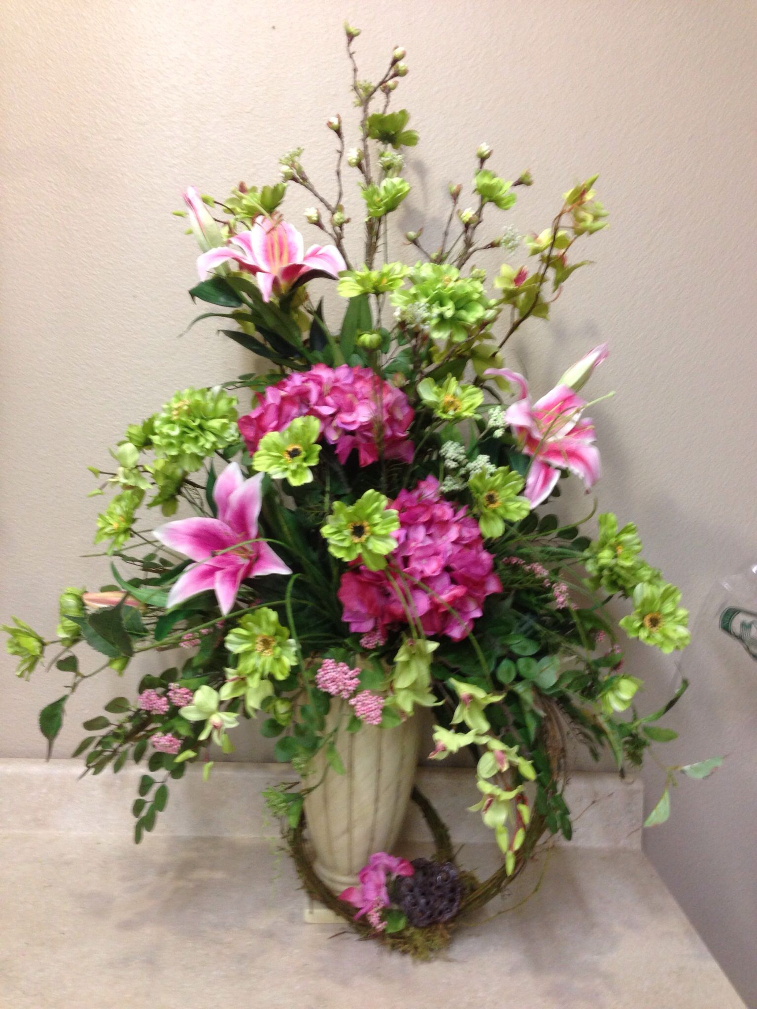 A pretty lush flower arrangement in a rustic wooden ... |Large Spring Floral Arrangements