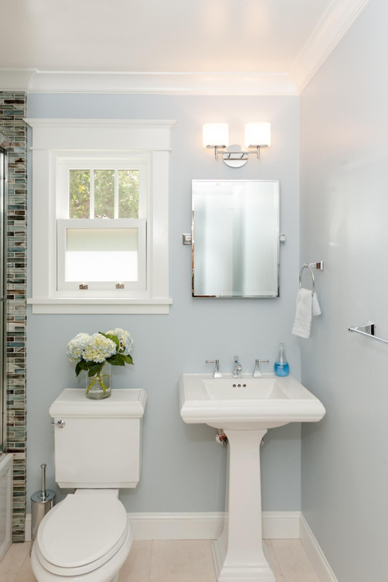This Bathroom Keeps It Minimalistic With A Serene Wall Color And
