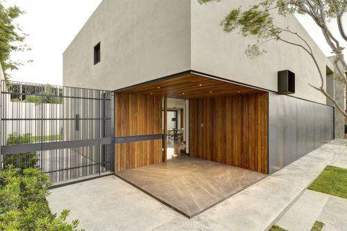 Porche D Entrée Bois porche d'entrée en bois et béton. « maison ovale » par l'architecte