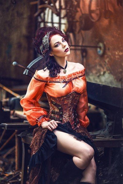 Steampunk Shades of Autumn (redhead in orange, brown and black color palette) - For costume tutorials, clothing guide, fashion inspiration photo gallery, calendar of Steampunk events, & more, visit SteampunkFashionGuide.com