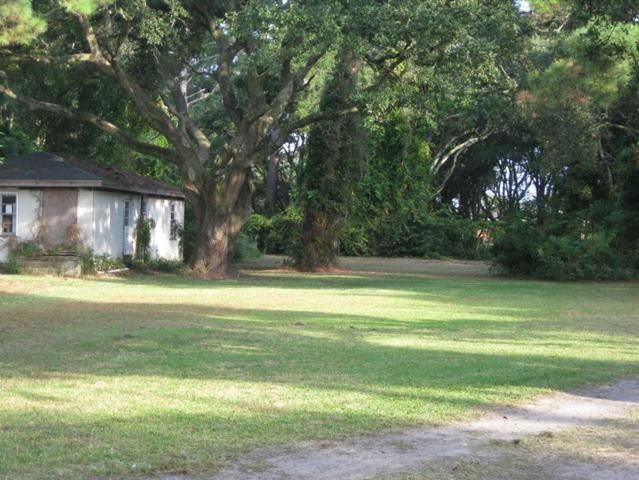 3204 & 3206 Abbott Morris Lane, Morehead City, NC   This is a rare find in the middle of Morehead City among beautiful oak trees 2 parcels just shy of one acre.  Potential for 4 duplexes or single family homes.  Close to the hospital medical offices shopping and boat ramp.