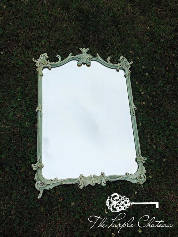 This gorgeous mirror would complete the look of any Hollywood Regency Boudoir or Shabby Chic French Style Room. With its unique shape and