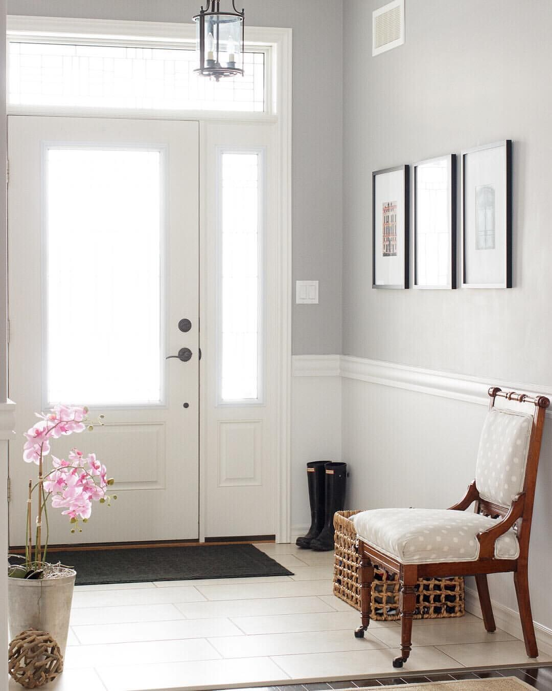 Bright Entry With Chair Rail And Grey Walls.