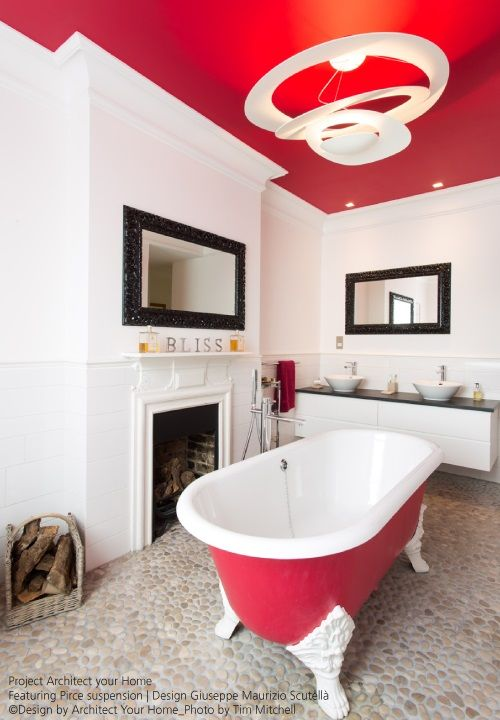 In this original bathroom, the red ceiling brings out the shape of ...