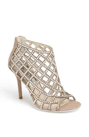 3fd7dbc4528 MICHAEL Michael Kors  Yvonne  Bootie at Nordstrom.com. Glittering cage  straps dotted with faceted crystals light up an open-toe bootie designed  with a back ...