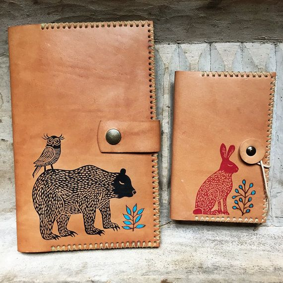 Hand stitched leather journal cover designed and made by Manolo. Burned decoration and stamp made by Geninne. Natural cowhide finished with wax salve.