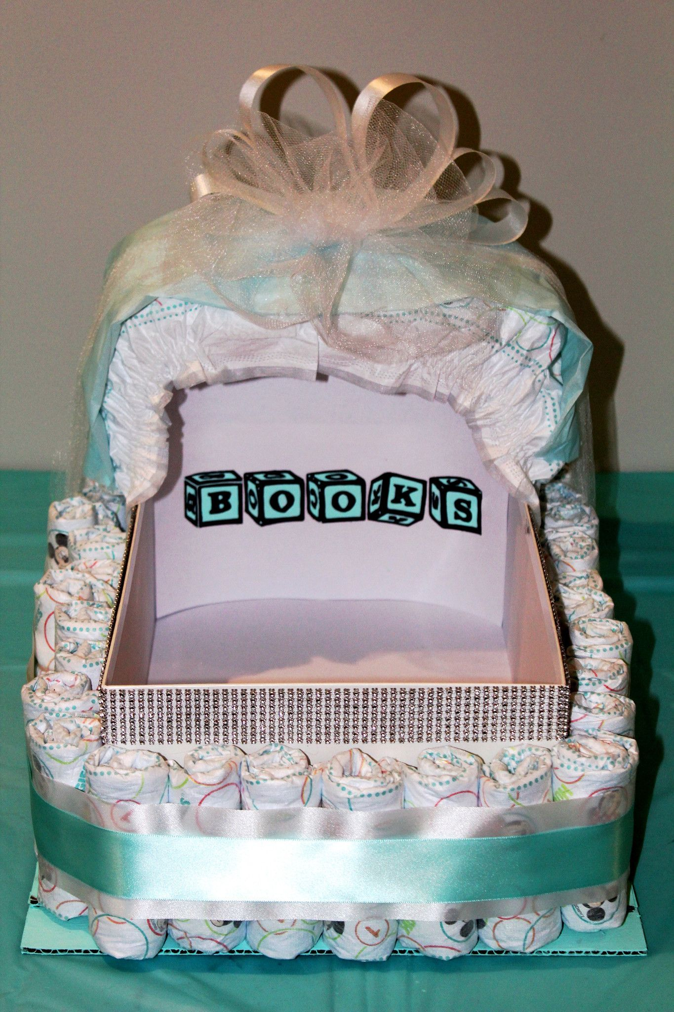 Shoe Box Frame Covered With Rolled Diapers And Decorative Ribbon