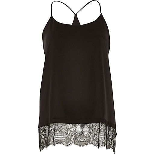 Black lace hem cami top at River Island  £20.00 -- Take the basic cami to the next level with this lace hem and loose fit.