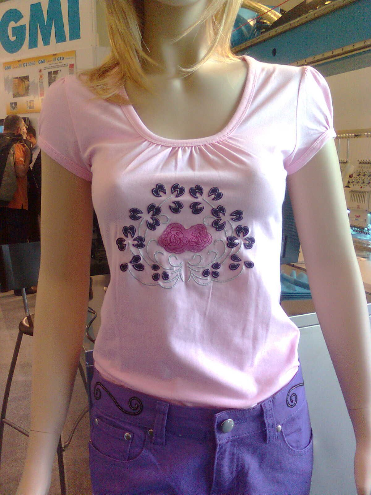 #T-shirt with laser cut and engrave applique and silver thread embroidery