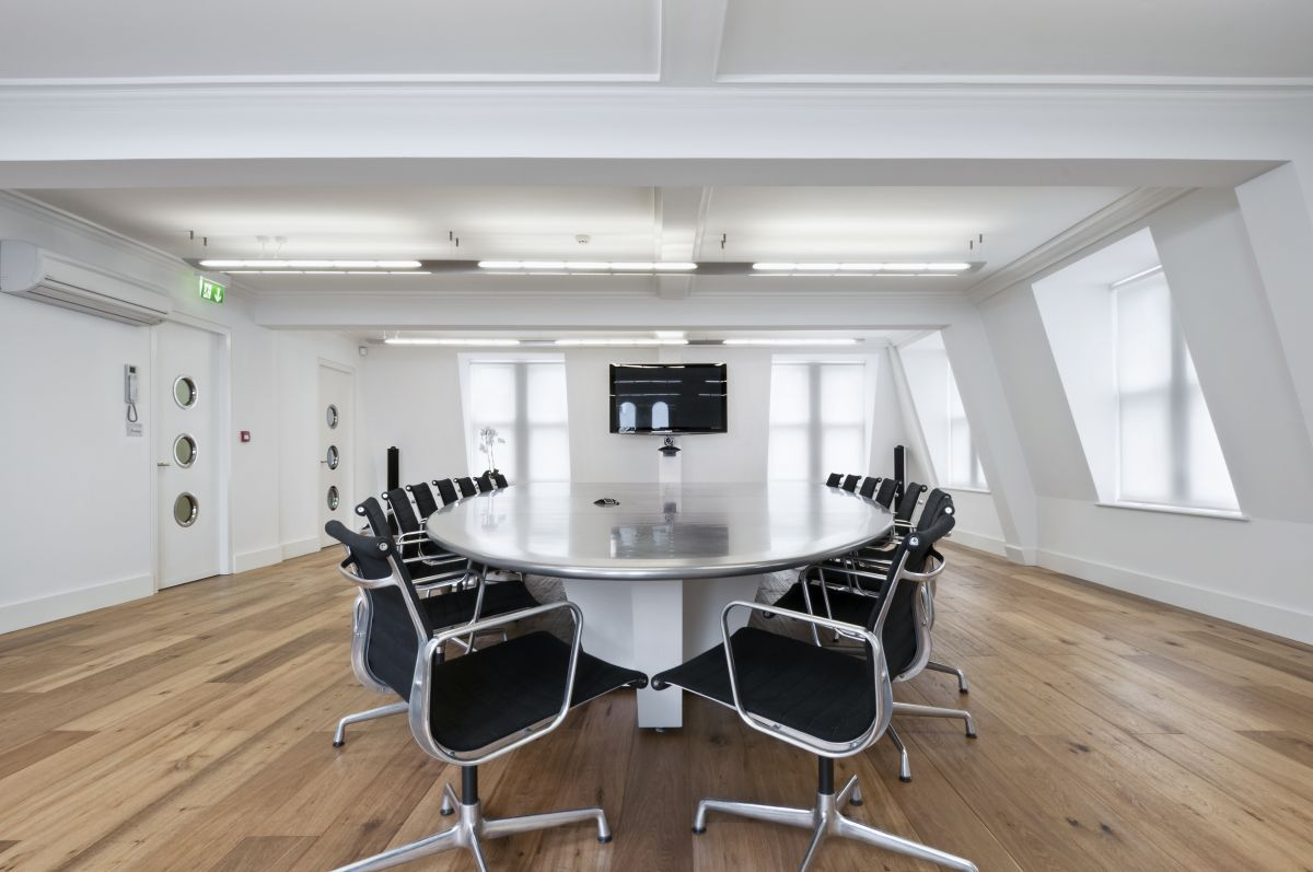 Lets start a meeting On Eames Aluminium Chairs by Vitra Office