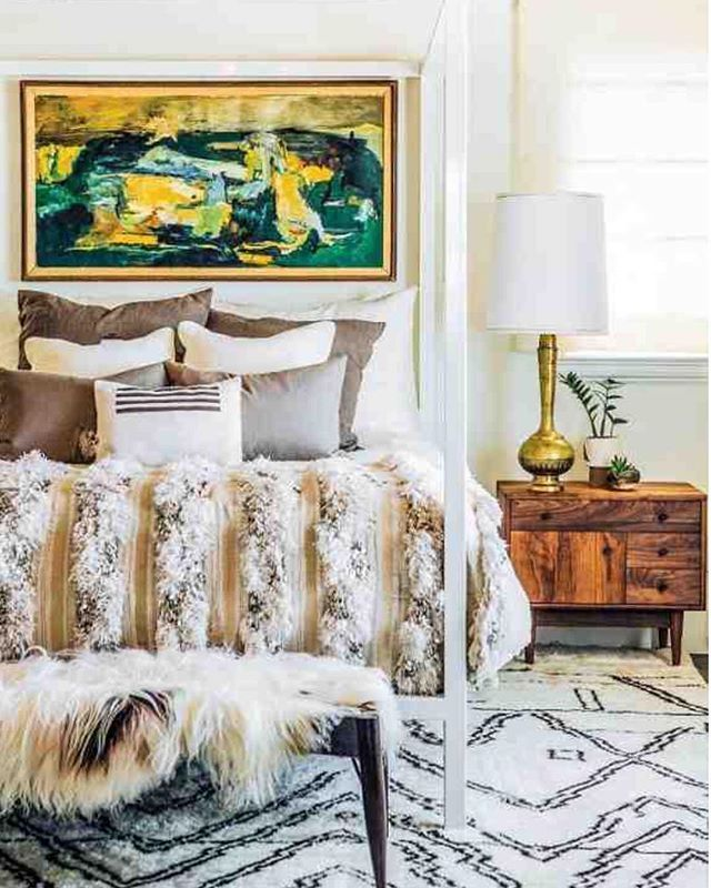 Love this cozy bedroom by Designer: Megan Tagliaferra! And that Morrocan wedding blanket!