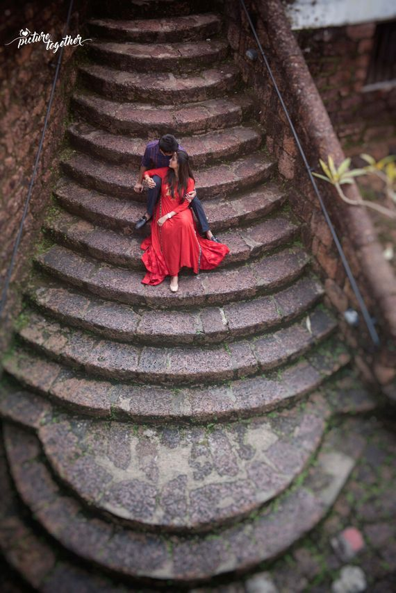 Photo of Top shot pre wedding shoot with couple on staircase