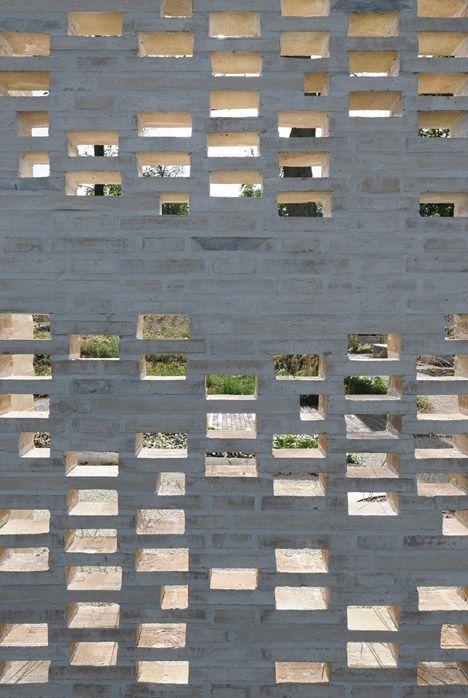 A perforated brick wall encloses a series of internal for Perforated brick wall