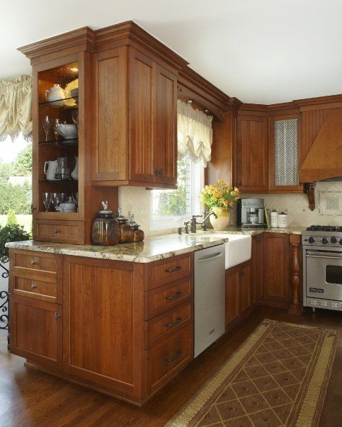 A Cottage style kitchen with cabinets of Vermont in Cherry with a ...