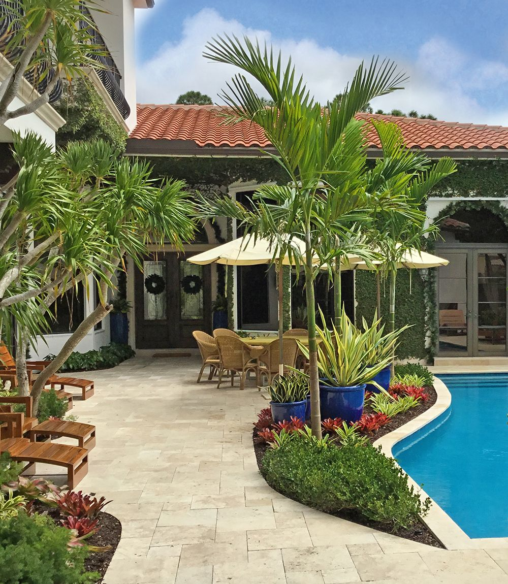 This pool in a garden is accented by tropical, colorful plantings ...