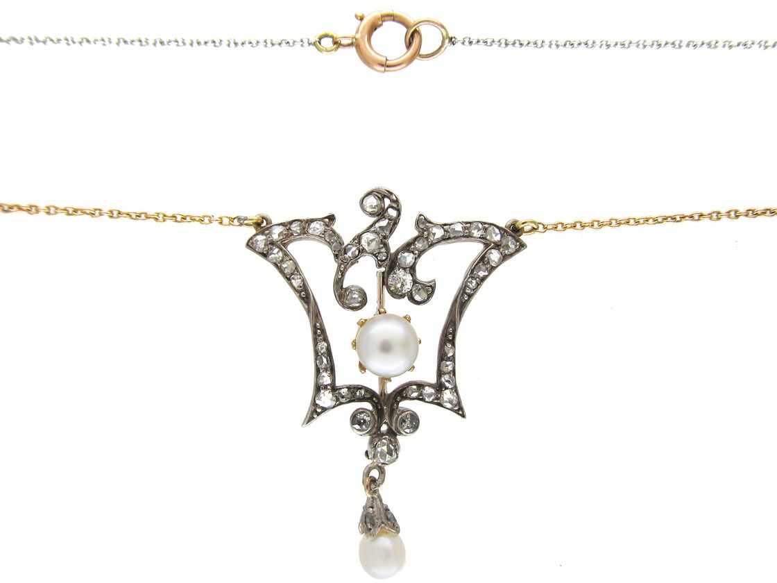 A very pretty diamond and pearl pendant which is attached to a two