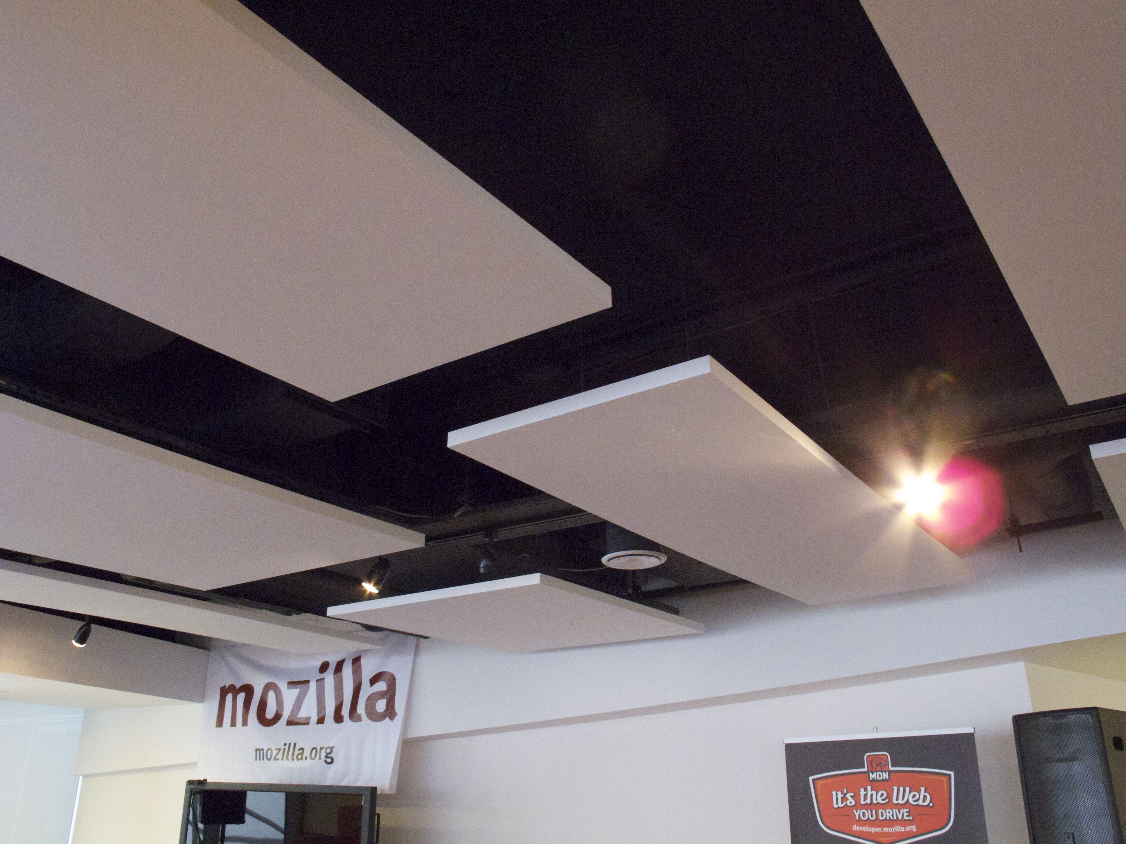 neat alternative to suspended ceiling in areas with ugly overhead