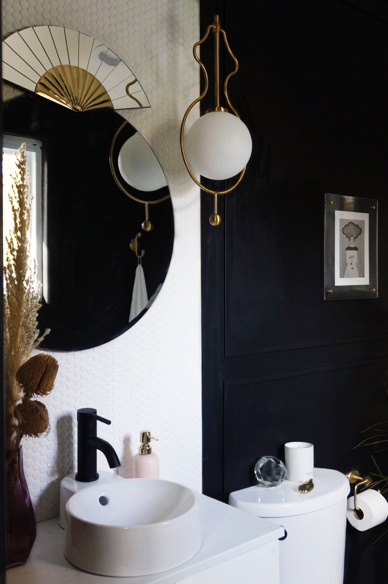 A black and white bathroom makeover with an art deco twist