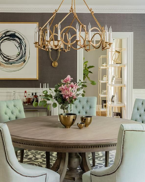 Living Room And Kitchen Stage By Synergy Staging: A Gold Leaf Ring Chandelier Takes Center Stage Over A