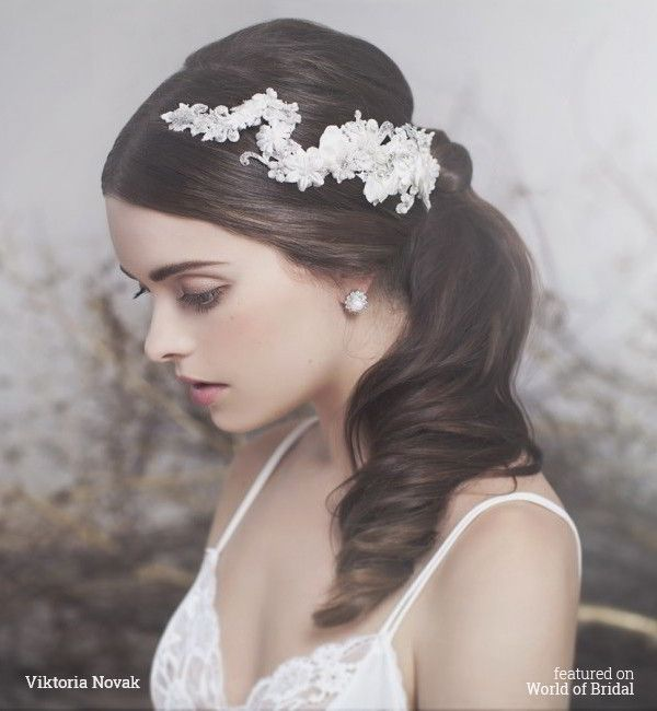 Ivory tone laces, silks complemented with delicate Swarovski crystals, ivory pearls and clear seed beads.