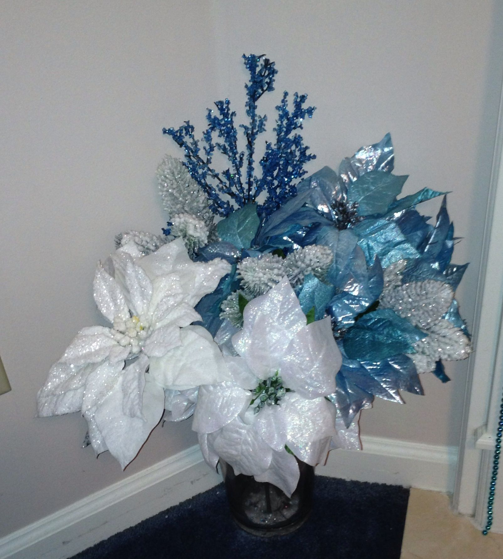 Blue White Poinsettia Arrangement Holiday Floral Holiday Floral Arrangements Craft Projects