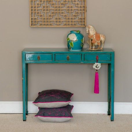 Our slim Perth console table fits neatly against a wall where space