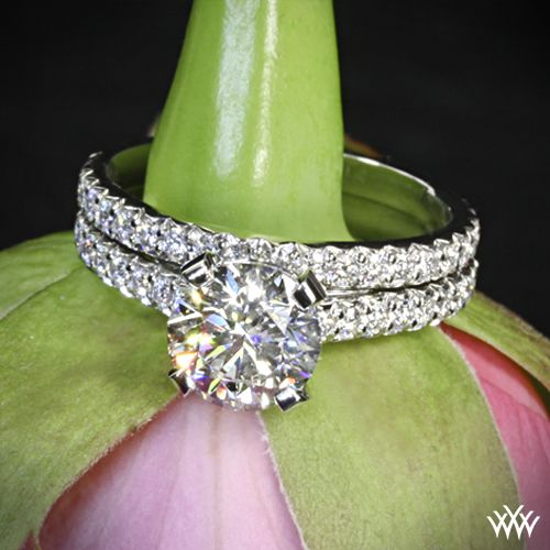 """beyond dazzling, the """"Elena"""" Diamond Wedding Set is sure to take her breathe away. The """"Elena"""" Diamond Engagement Ring holds 56 brilliant A CUT ABOVE® Hearts and Arrows Diamond Melee (0.50ctw; F/G VS), while the """"Elena"""" Diamond Wedding Ring shines with 29 A CUT ABOVE® Hearts and Arrows Diamond Melee"""