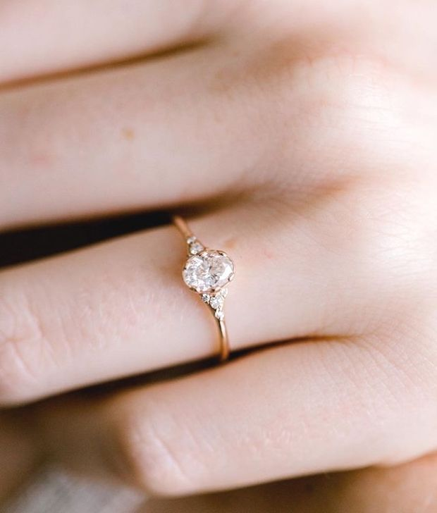 Oval Ladys Slipper ring with a half carat white diamond set in 14k rose gold More information at