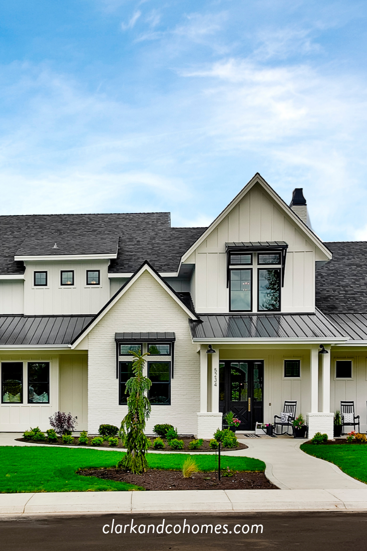 The Heartland The Exterior Of This Modern Farmhouse Home Features Black Windows Metal Awni Brick Exterior House Modern Farmhouse Exterior Painted Brick House