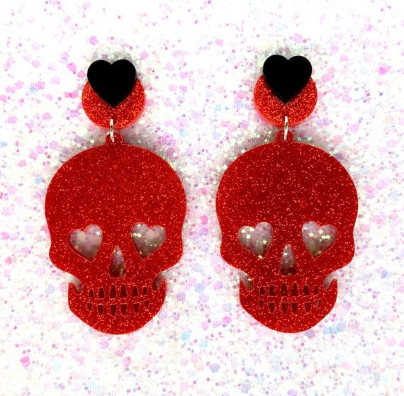 Do you have a love for skulls and for the supernatural!?! Or do you just love awesome jewelry!?! Either way, these earrings are just what you need to spruce up any spooky outfit! Available in 5 eerily rockin colors! Get one color or hell, get them all! Materials and Dimension: Skulls are 2 tall, #spookyoutfits