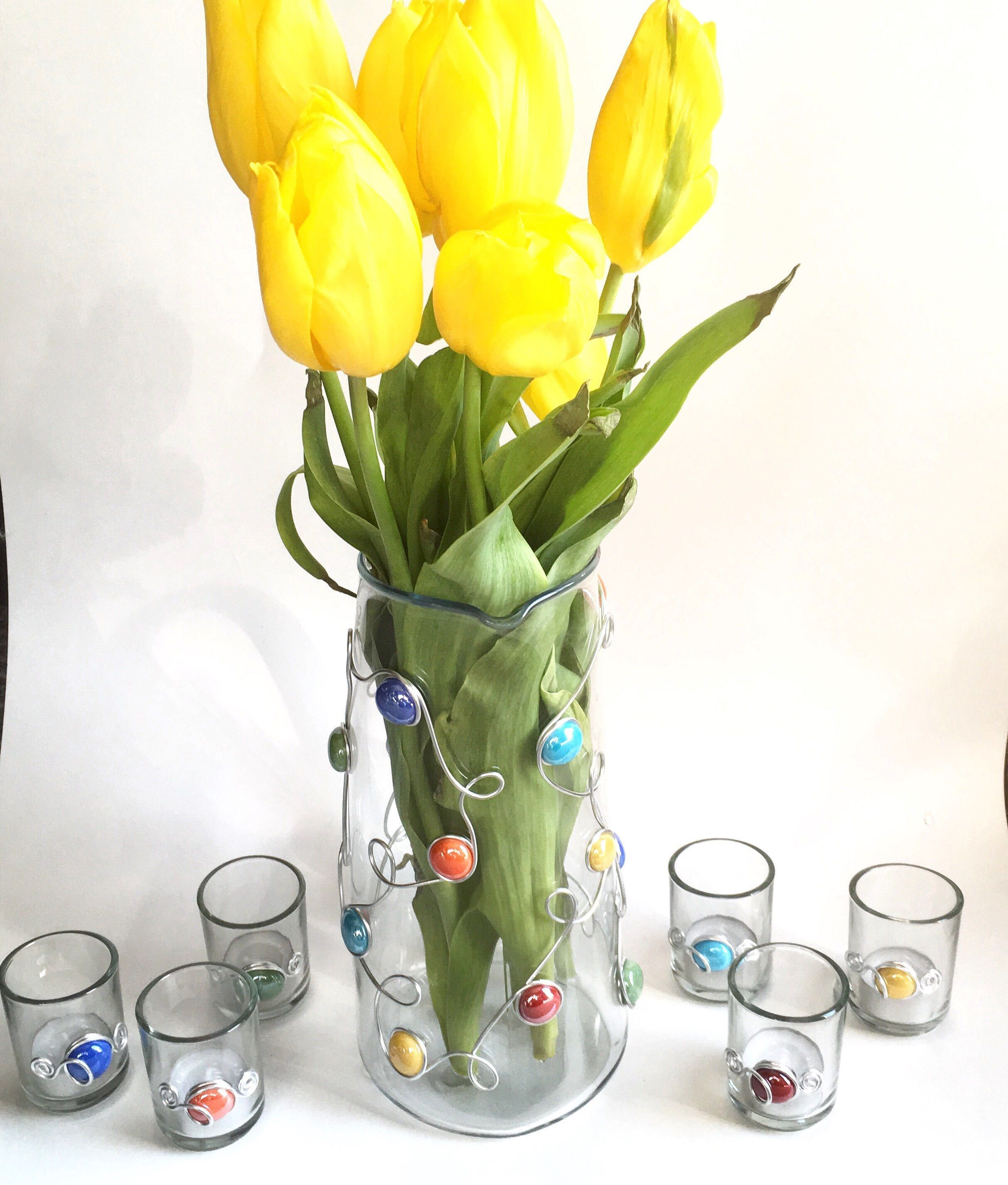 Dress up your event with this pitcher vase u candle holder set
