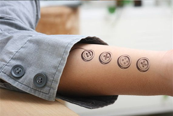 68 Beautiful Temporary Tattoos You Ll Want To Keep Forever Button Tattoo Sewing Tattoos Whimsical Tattoos