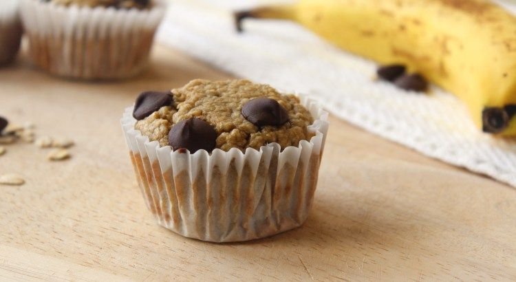 Preheat oven to 375° F. Lightly grease or line a muffin tin with liners. Place all ingredients in a food processor or blender. Blend until smooth and well combined. Stir in chocolate chips. Scoop batter into muffin tin using a large scoop or small measuring cup (about 1/4 cup per muffin). Top with additional chocolate chips if desired. Bake muffins at 375° F for 10-15 minutes or until a toothpick inserted in the center comes out clean. Remove from oven and let cool slightly (for at least 5…