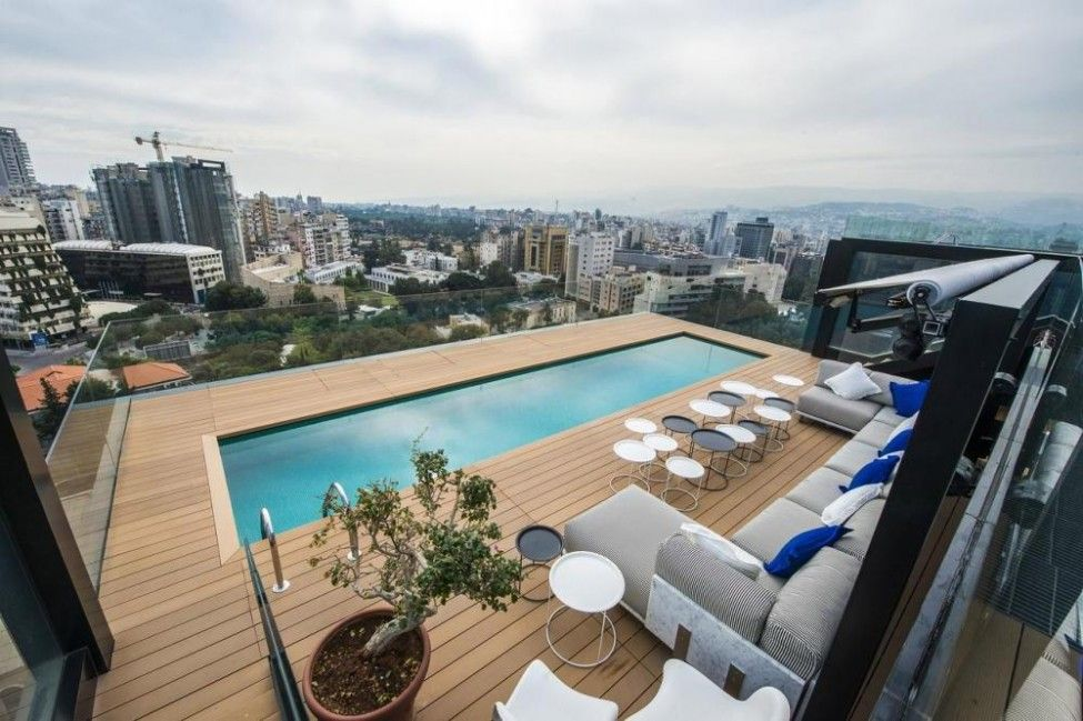 Modern House With Swimming Pool On Roof Equipped Lounge Area City View In