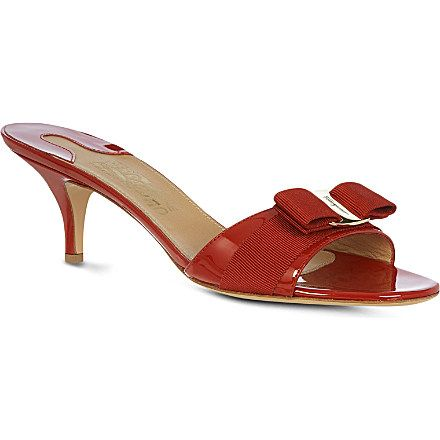 Classic and elegant with a peep-toe front and patent leather finish, the beauty of Ferragamo's Glory 1 sandals is their timeless appeal.