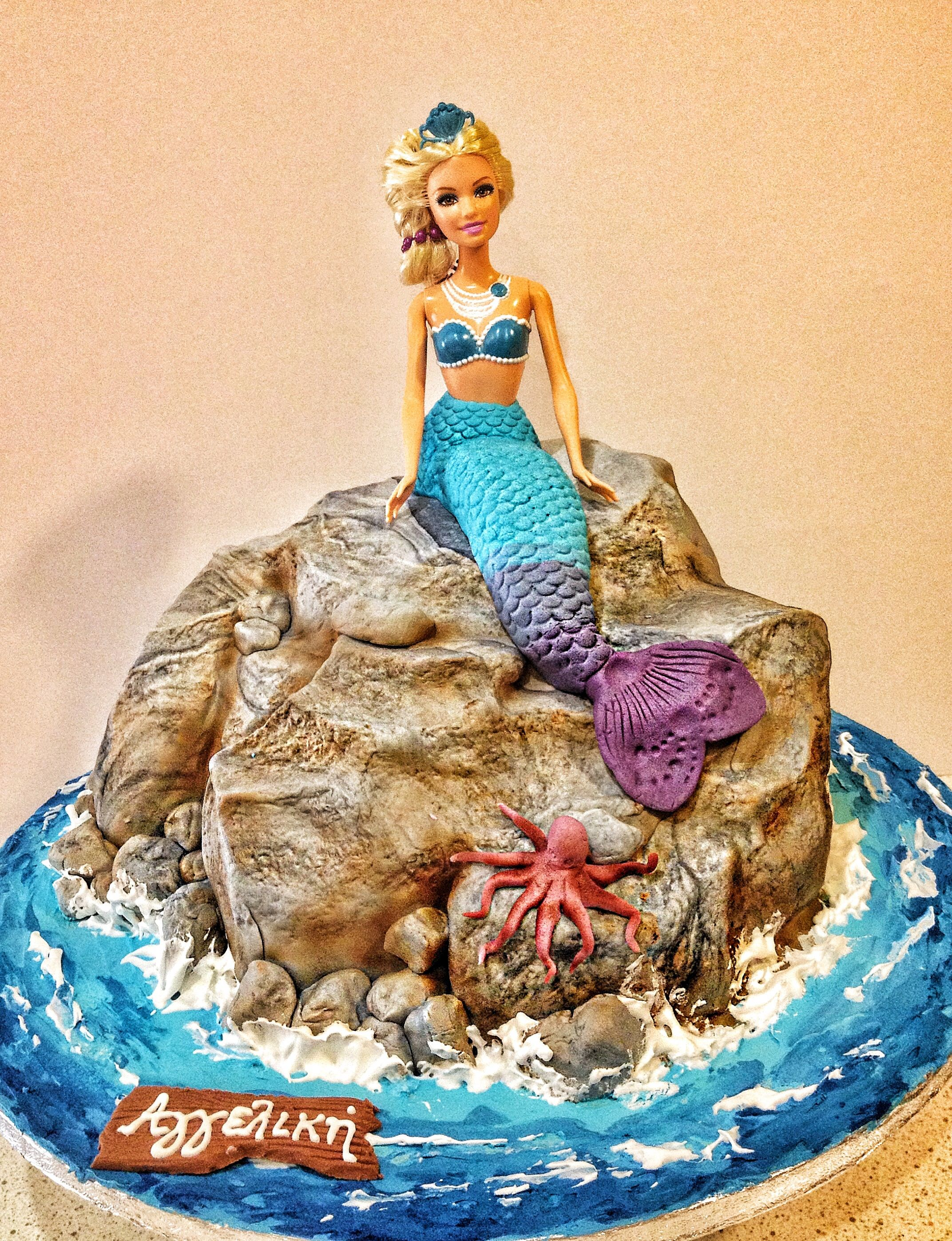 Barbie Merlia on a rock birthday cake