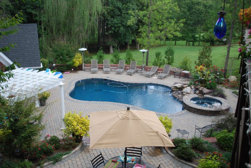 Landscaping a pool area ideas pool area landscaping for Landscape design for pool areas
